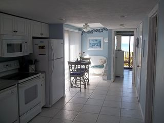Manasota Key condo photo - Condo # 121 - Kitchen and Sitting Area (or Extra Dining Area with View)
