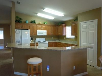 Kitchen, granite counter, new cabinets, dish washer, sink, refrig, open concept