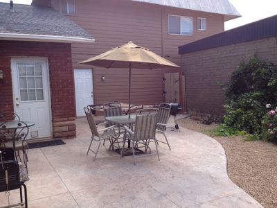 Spacious patio with 2 BBQ Grills, 2 Tables, 6 chairs, Umbrella, and 2 Hammocks.