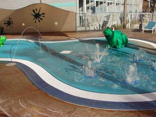 "Enclosed ""Splash Pad"" area for toddlers"