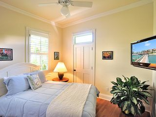 Key West house photo - The 6th bedroom is on main floor, with queen bed, flat screen TV/DVD.