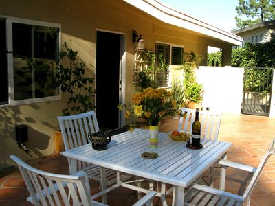Private backyard patio with garden table and chairs. Perfect for morning coffee!