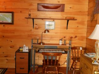 Green Lake cabin photo - Entry room includes closet, shelves and electronic keyboard