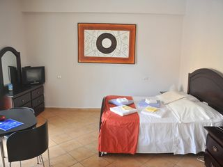 Punta Cana studio photo - your studio with queen-size bed, cable tv with local art paintings