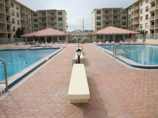 New Smyrna Beach condo photo - Two large pools plus a kiddie pool