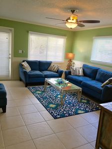 Inviting & Comfortable Living Room; Plenty of Seating & 55 inch flat screenT