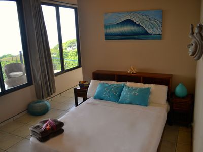Ocean view bedroom with access to patio balcony