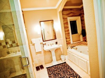 Bathroom between King and Queen Room. Lake views.