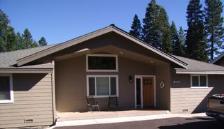 Lake Almanor house photo - Front of home with circle drive way & room to play