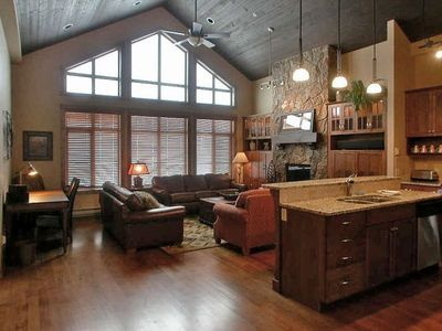 Spacious living area with 24' vaulted wood ceiling and cathedral windows