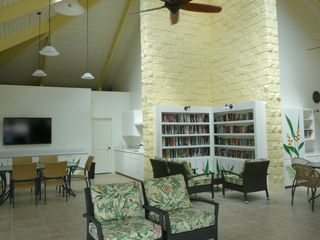Princeville condo photo - Newly remodeled recreation room with library, big-screen TV and lounge.
