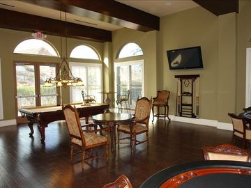 Rec Room area in clubhouse with pool table, chess table, poker table, wet bar