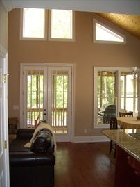 Lake Martin cabin rental - View of the open area top floor living space. Rustic and quaint.