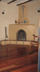 Santa Fe house photo - Kiva fireplace in living room