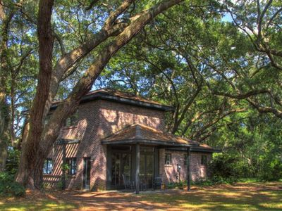 Entrance - House nestled midst Live Oak trees overlooks St. Helena Sound.