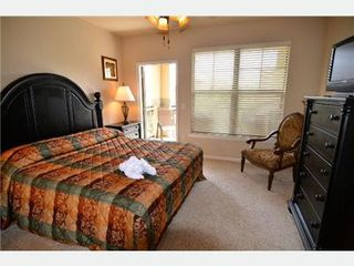 Massive Master suite with 32 inch tv, high def cable, dvd player... - Bella Piazza condo vacation rental photo