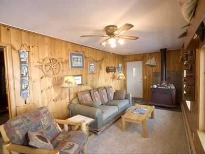 Duluth house rental - Family Room with fireplace & lake view