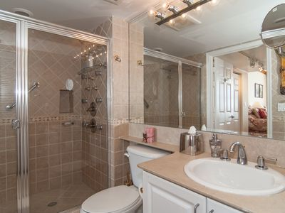 Bathroom adjoining second bedroom with shower including massage jets