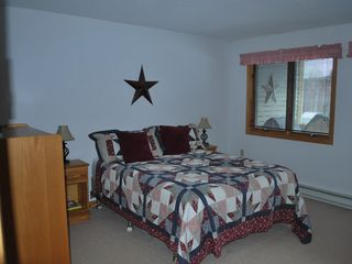 North Conway condo photo - Queen bed with full bath off of it.