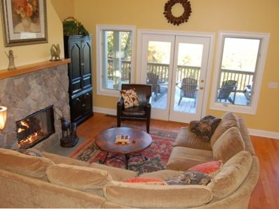 Great Room with Luxury Sectional, Oriental Rug and Stone Gas Fireplace