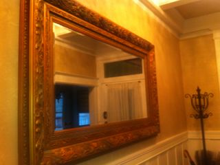 Stunning details everywhere. This mirror is in the foyer below a beamed ceiling