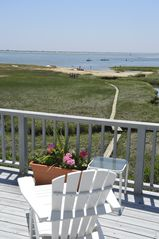 Chatham house photo - Relax on the azek white adirondack chair with slide out foot rest...