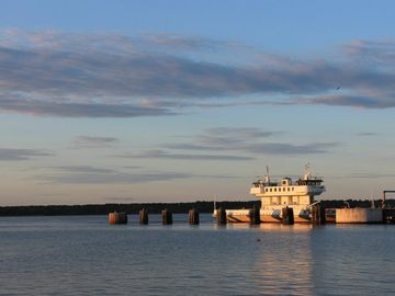 The ferry, as the sun is setting, serves as your personal cruise transportation.