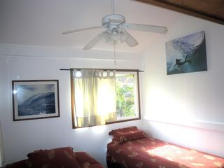 Sunset Beach house photo - one of the bedrooms upstairs with Queen & twin, TV , AC,