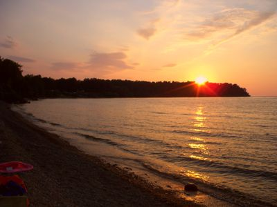 Sodus Bay cottage rental - Sunsets from beach area can be seen from deck, windows or fire pit area.