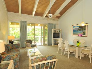 Napili condo photo - View of living room open floor plan. Flows onto generous lanai.