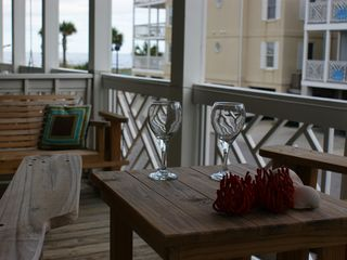 Tybee Island condo photo - Ready for a glass of wine on the porch, or nap on the extraa long glider.