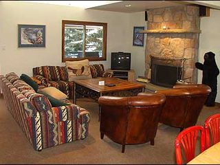 Aspen house photo - Great Room features stone fireplace and comfortable seating.
