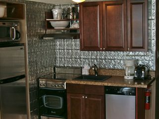 Meridian Plaza condo photo - Fridge, stove, dishwasher, crock pot, blender,pots and pans, microwave.