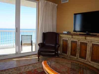 Large flat screeen TV and balcony view of the crystal blue gulf waters.