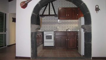 Traditional, but fully equipped kitchen with view to the ocean while you cook.