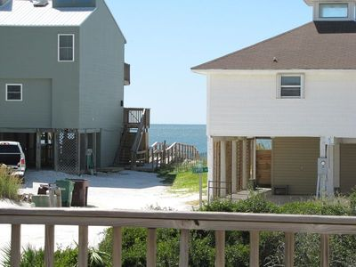 View of water from screen porch, beach access between two gulf front homes,