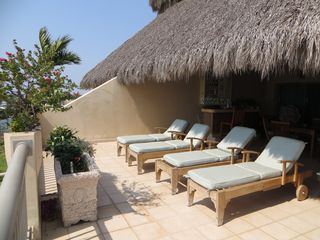 Nuevo Vallarta condo photo - Private sunbathing on your own palapa. Includes bar and dining area 30 by 30