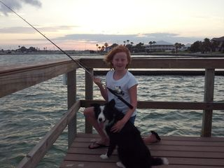 Rockport house photo - Family fishing at sunset - speckled trout is often caught