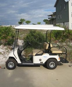 Golf cart available to ride to the beach.