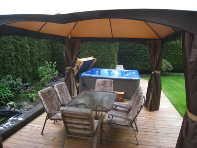 Backyard patio with hot tub and gazebo