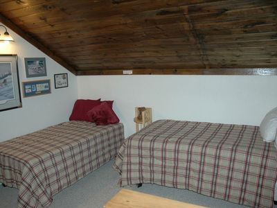 The sleeping loft upstairs has two twin beds.