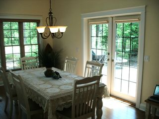 New Buffalo cottage photo - Dining area looking out on the open deck