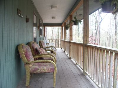 Main House - wrap around deck with great view of the wooded acres.
