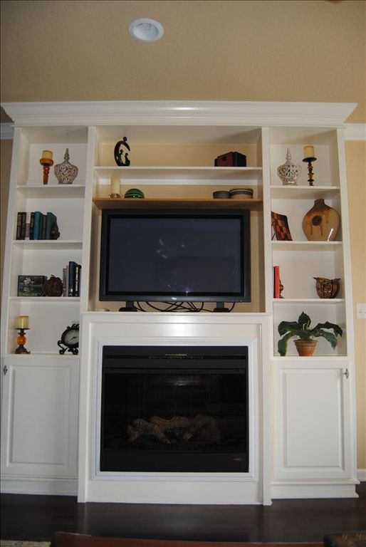 Entertainment center with electric fireplace.