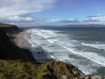 Downhill beach from cliffs at Castlerock with Donegal hills in the distance.