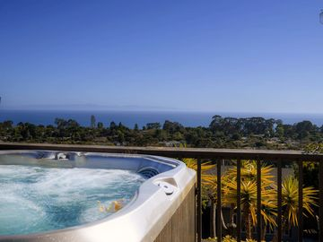 Hope Ranch house rental - On clearer days, the Channel Islands are easily visible from the hot tub. The tall cluster of trees on the right is Douglas Preserve, a great place to take an afternoon walk.