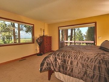 Upstairs master suite with serene views of Mt. Tallac, meadow and lake