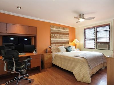 "Large bedroom with king sized bed and 42"" TV"