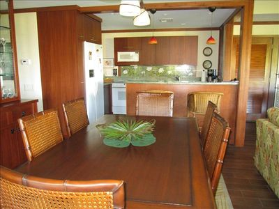 DINING AREA WITH ACCESS TO LANAI. KITCHEN WITH ACCESS TO LIVING AND DINING AREA