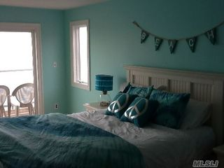 Montauk house photo - Queen Bedroom on waterfront with deck over loo king Sounds